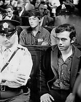 Raymond Villeneuve; Student and other <br /> FLQ Bomb suspects sit in court today surrounded by Montreal and Quebec provincial police. FLQ is a terrorist organization dedicated to the removal of Quebec from Confederation. The suspects for the most part were young and shabbily dressed. They all were in need of haircuts.<br /> <br /> 1963<br /> <br /> PHOTO :  Frank Grant - Toronto Star Archives - AQP