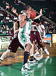 North Texas Mean Green forward Kedrick Hogans (24) gets a rebound in the game between the Texas State Bobcats and the University of North Texas Mean Green at the North Texas Coliseum,the Super Pit, in Denton, Texas. UNT defeated Texas State 85 to 62