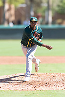 Oakland Athletics relief pitcher Leudeny Pineda (59) follows through on his delivery during an Instructional League game against the Los Angeles Dodgers at Camelback Ranch on September 27, 2018 in Glendale, Arizona. (Zachary Lucy/Four Seam Images)