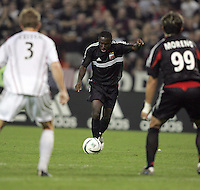 30 October,  2004. DC United's  Freddy Adu (9) takes a shot during the 2004 MLS playoffs at RFK Stadium in Washington, DC.