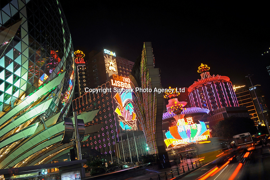 """Casinos light up the main boulevard and centre of Macau. Macau is known simply as """"Vegas"""" in China. The former Portuguese colony, now a Chinese Special Administrative Region, attracts millions of Chinese gamblers annually and last year earned more gambling dollars than Las Vegas.."""