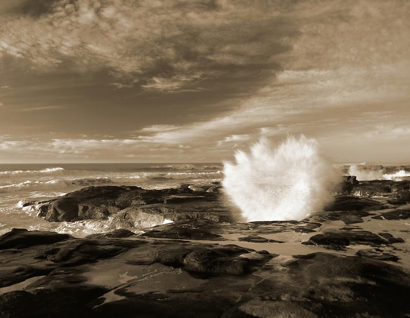 Storm waves and rocky shoreline at Smelt Sands State Park, Oregon