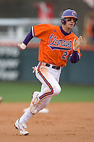 Matt Sanders #21 of the Clemson Tigers hustles towards third base at Doug Kingsmore stadium March 13, 2009 in Clemson, SC. (Photo by Brian Westerholt / Four Seam Images)