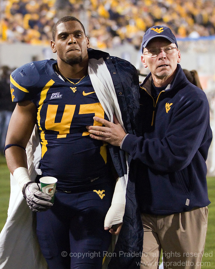 WVU linebacker Doug Rigg heads to the locker room with an injury. The WVU Mountaineers beat the Pitt Panthers 21-20 at Mountaineer Field in Morgantown, West Virginia on November 25, 2011.