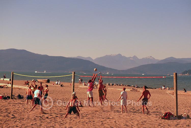 People playing Beach Volleyball at Spanish Banks along English Bay, Vancouver, BC, British Columbia, Canada - Coast Mountains, Summer