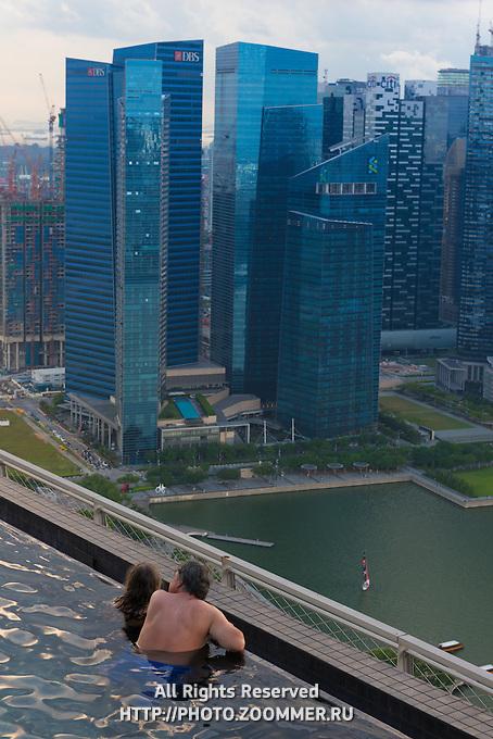 Infinity Pool Swimmers Enjoy Singapore Panoramic View