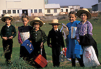 """AJ2218, Amish, children, Pennsylvania, Lancaster County, White Horse, A group of Amish children in front a farm waiting for the """"""""Buggy Bus"""""""" going to school in Lancaster County. The boys are wearing traditional straw hats."""