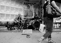 """Toronto (ON) CANADA,  April , 2008-...Street Musician playing (Social Distorsion's version of ) Johhny Cash """"Ring of Fire' on Queen street.."""