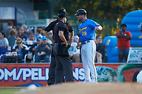 Myrtle Beach Pelicans manager Steve Lerud (39) argues with umpires Jake Bruner and Mark Bass during the game against the Winston-Salem Dash at TicketReturn.com Field on May 16, 2019 in Myrtle Beach, South Carolina. The Dash defeated the Pelicans 6-0. (Brian Westerholt/Four Seam Images)