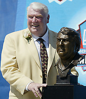 John Madden, coach of the Oakland Raiders for 10 seasons, poses with his bust during the Pro Football Hall of Fame induction ceremony Saturday, Aug. 5, 2006, in Canton, Ohio.<br />