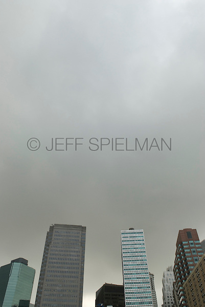 Upward View of Office Buildings and Overcast Gray Sky over Lower Manhattan's Financial District, New York City, New York State, USA