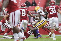 Arkansas defensive back Montaric Brown (21) tackles LSU wide receiver Terrace Marshall Jr. (6), Saturday, November 21, 2020 during the third quarter of a football game at Donald W. Reynolds Razorback Stadium in Fayetteville. Check out nwaonline.com/201122Daily/ for today's photo gallery. <br /> (NWA Democrat-Gazette/Charlie Kaijo)