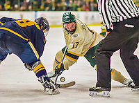 29 December 2013:  University of Vermont Catamount Forward Jake Fallon, a Junior from Southlake, Texas, takes a second period face-off against the Canisius College Golden Griffins at Gutterson Fieldhouse in Burlington, Vermont. The Catamounts defeated the Golden Griffins 6-2 to capture the 2013 Sheraton/TD Bank Catamount Cup NCAA Hockey Tournament for the second straight year. Mandatory Credit: Ed Wolfstein Photo *** RAW (NEF) Image File Available ***