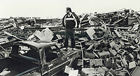 1985 FILE PHOTO - ARCHIVES -<br /> <br /> Ron McKittrick of Morrow Rd. in Barrie stands on hood of his truck as he surveys the rubble that was his ATLAS Auto Supply Company<br /> <br /> 1985<br /> <br /> PHOTO :  Erin Comb - Toronto Star Archives - AQP