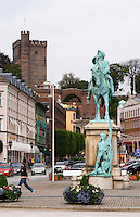 Equestrian statue with Magnus Gustafsson Stenbock on the Hamntorget Harbour Square, heroic early 18th century military figure, defender of the Swedish province of Scania against invading Danes. The Kärnan medieval tower. Helsingborg, Skane, Scania. Sweden, Europe.