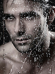 Dramatic closeup portrait of a man face wet from water pouring on it Image © MaximImages, License at https://www.maximimages.com