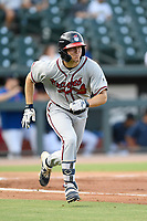 Left fielder Andrew Moritz (25) of the Rome Braves runs out a batted ball in a game against the Columbia Fireflies on Tuesday, June 4, 2019, at Segra Park in Columbia, South Carolina. Columbia won, 3-2. (Tom Priddy/Four Seam Images)