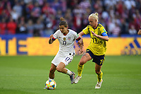 LE HAVRE, FRANCE - JUNE 20: Tobin Heath #17, Caroline Seger #17 during a 2019 FIFA Women's World Cup France group F match between the United States and Sweden at Stade Océane on June 20, 2019 in Le Havre, France.