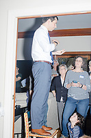 Democratic presidential candidate and South Bend mayor Pete Buttigieg speaks at a house party with the Bedford Democrats in Bedford, New Hampshire, on Sat., Apr. 20, 2019. The candidate stood on a chair throughout his speech.