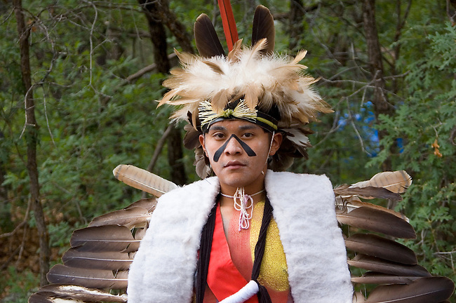Traditional Hopi teenage Eagle dancer, Alrye Polequaptwa, dressed in dance regalia of eagle feather headdress with eagle feather wings during the annual Hopi Indian Festival at the Museum of Northern Arizona, Flagstaff