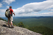 Caribou - Speckled Mountain Wilderness - A hiker takes in the view along Mud Brook Trail in the White Mountain National Forest of Maine. Mud Brook Trail travels to the summit of Caribou Mountain