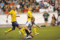 Amy Rodriguez  attempts a diving header...USWNT tied Sweden 1-1 at Morison Stadium, Nebraska.