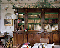 The reading room on the ground floor features a naive mural executed in the 1990's, featuring birds and fauna and ivy above a vast antique bookcase