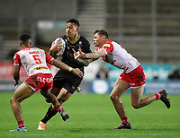 20th November 2020; Totally Wicked Stadium, Saint Helens, Merseyside, England; BetFred Super League Playoff Rugby, Saint Helens Saints v Catalan Dragons; Israel Folau of Catalan Dragons takes on Jack Welsby and Regan Grace of St Helens