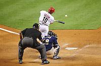 May 27, 2009; Phoenix, AZ, USA; Arizona Diamondbacks batter Justin Upton hits a two run triple in the sixth inning against the San Diego Padres at Chase Field. Mandatory Credit: Mark J. Rebilas-