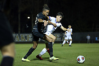 WINSTON-SALEM, NC - DECEMBER 07: Calvin Harris #22 of Wake Forest University and Mateo Restrepo Mejia #14 of the University of California Santa Barbara challenge for the ball during a game between UC Santa Barbara and Wake Forest at W. Dennie Spry Stadium on December 07, 2019 in Winston-Salem, North Carolina.