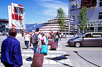 "Tourists arriving at ""Canada Place"" Trade and Convention Centre and Cruise Ship Terminal and the New Tourist Welcome Centre and Information Booth, Vancouver, British Columbia, Canada"