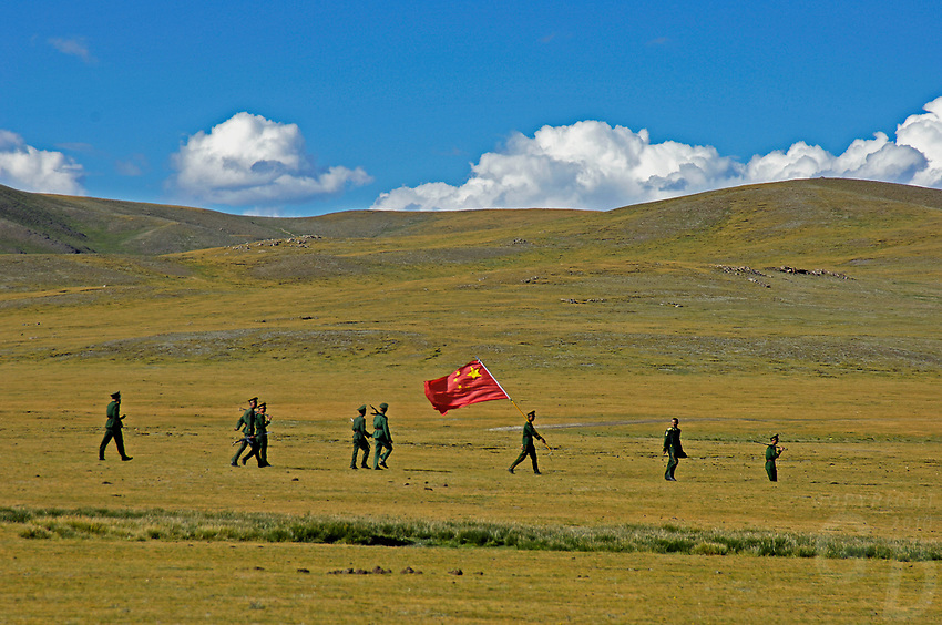 Chinese Soldiers with Chinese Flag in Tibet's province of Nakchu in Tibet hosts many festivals throughout the year, but one stands out more than any other; it is the highest horse racing festival in the world – a spectacle of colour, festivities and endurance for participants and visitors alike.<br /> Over 10,000 people will cross high passes of more than 4,000 metres by foot, horse and jeep to make their way to the Nakchu Racecourse, to race, eat, drink and make merry during this annual festival. This racecourse, at 4,500 metres, is undoubtedly the highest racecourse in the world.
