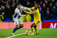 Martin Montoya of Brighton & Hove Albion (22)  and Wilfried Zaha of Crystal Palace challenge for the ball ,during the Premier League match between Brighton and Hove Albion and Crystal Palace at the American Express Community Stadium, Brighton and Hove, England on 4 December 2018. Photo by Edward Thomas / PRiME Media Images.
