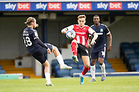Archie Collins of Exeter City challenges Kyle Taylor, Southend United during Southend United vs Exeter City, Sky Bet EFL League 2 Football at Roots Hall on 10th October 2020