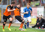 Dundee United v St Johnstone...27.09.14  SPFL<br /> Liam Caddis is tackled by Paul Paton<br /> Picture by Graeme Hart.<br /> Copyright Perthshire Picture Agency<br /> Tel: 01738 623350  Mobile: 07990 594431