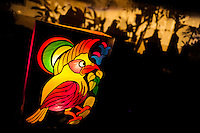 A colorful paper lantern, depicting a bird from tropical rainforests of Amazonia, illuminates the street during the anual Festival of Candles and Lanterns in Quimbaya, Colombia, 8 December 2013. A vibrant event, celebrated since 1982 and attracting tens of thousands of visitors every year, is held in honor of the Virgin Mary, on the day of the Catholic Feast of the Immaculate Conception. Each street and neighborhood in the town compete in the contest to create the most spectacular lighting arrangement of their place, employing creatively elaborated lantern designs, which range from religious themes, to symbols of the coffee region or the environmental and wild nature motives. All the streets in Quimbaya center close for one night and some 40,000 lanterns are being lightened up at the festive night.