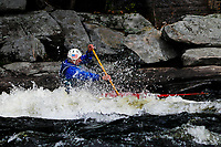 Kayaker competing in the Hudson River White Water Derby in the Adirondack Forest Preserve, New York
