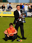 Dejected AFC Fylde players watch is the Promotion trophy is brought onto the pitch. Vanarama National League North, Promotion Final, North Ferriby United v AFC Fylde, 14th May 2016.