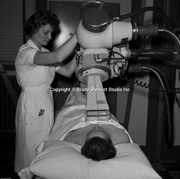 Client: Pittsburgh Skin and Cancer Foundation<br /> Contact: Mr. Grunlish<br /> Product: GEC X-Ray Equipment<br /> Location: Presbyterian Hospital<br /> <br /> Technician using new GEC X-Ray equipment in operation in the hospital.