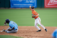 Baltimore Orioles Adam Hall (51) looks to first holding the throw as Jesus Sanchez (71) slides into second base during an Instructional League game against the Tampa Bay Rays on October 5, 2017 at Ed Smith Stadium in Sarasota, Florida.  (Mike Janes/Four Seam Images)