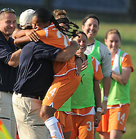 Skyblue forward Francielle celebrates the game-winning goal with coach Mike Lyons. The Skyblue FC defeated the Washington Freedom 2-1 in first round of WPS playoffs at the Maryland Soccerplex, Saturday, August 15, 2009.