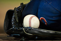 An AZL Cubs cap and baseball sit inside a glove in the dugout during a game between the AZL Cubs and AZL Giants on September 5, 2017 at Scottsdale Stadium in Scottsdale, Arizona. AZL Cubs defeated the AZL Giants 10-4 to take a 1-0 lead in the Arizona League Championship Series. (Zachary Lucy/Four Seam Images)