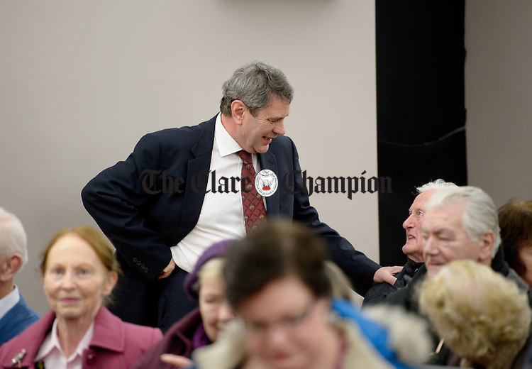 Dr. Michael Harty chatting with supporters before a public meeting as part of the #nodoctornvillage campaign in Corofin Hall. The meeting ratified Dr. Michael Harty as the Clare GP candidate for the forthcoming General election. Photograph by John Kelly.