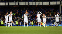 Liverpool, UK. Saturday 01 November 2014<br /> Pictured L-R: Swansea players Wayne Routledge, ANgel Rangel, Ashley Williams, Ki Sung Yueng, Thomas Carroll and Bafetimbi Gomis thank their away supporters as they walk off the pitch after the end of the game. <br /> Re: Premier League Everton v Swansea City FC at Goodison Park, Liverpool, Merseyside, UK.