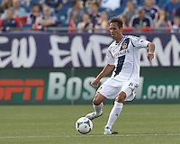 LA Galaxy midfielder Marcelo Sarvas (8) passes the ball.  In a Major League Soccer (MLS) match, the New England Revolution (blue) defeated LA Galaxy (white), 5-0, at Gillette Stadium on June 2, 2013.