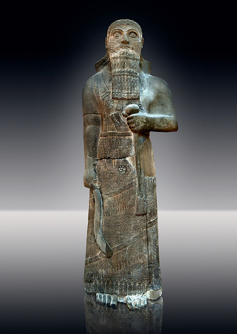 """Neo-Assyrian basalt statue of King Shalmaneser III (858-824 B.C) . Inscription reads """"Shalmaneser, the great king, the mighty king, king of all four region, the powerful and the mighty rival of the princes of the whole earth the great ones, the kings, son of Assur-Nasirapli, King of the universe, King of Assyria, grandson of ~Tukultiu-Ninurta, King of the Universe, King of Assyria"""". The inscription continues with his campaigns &b deeds in Uratu, Syria, Que & Tabal ending """" At the time I rebuilt the walls of my city Ashur from their foundations to their summits. I made an image of my royal self and set it up in the metal gate"""". From Assur ( Qala't Sharqat) Iraq. Istanbul Archaeological Museum, Inv no. 4650."""