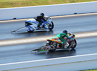 Apr. 29, 2011; Baytown, TX, USA: NHRA pro stock motorcycle rider Shawn Gann (near) races Gerald Savoie during qualifying for the Spring Nationals at Royal Purple Raceway. Mandatory Credit: Mark J. Rebilas-