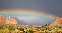 A large rainbow appears after a storm passes through Cathedral Valley at Capitol Reef National Park, Utah