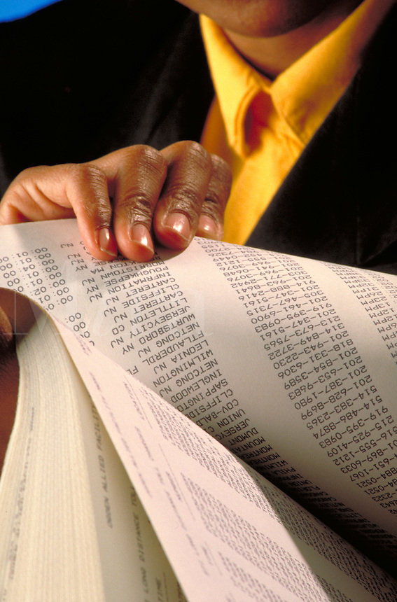 woman's hands, holding, looking at computer printouts, financial statements, business.