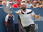 Marcos Baghdatis (CYP), battles against Stanislaus Wawrinka (SUI)  at the US Open being played at USTA Billie Jean King National Tennis Center in Flushing, NY on September 1, 2013